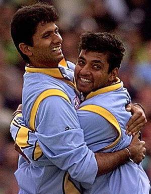 India's pace bowler Venkatesh Prasad is hugged by teammate Ajay Jadeja after taking a wicket against Pakistan on June 8, during their World Cup super six match at Old Trafford.