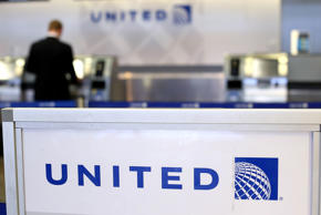 A sign is posted in front of a United Airlines ticket counter at San Francisco International Airport on July 26, 2012 in San Francisco, Calif.