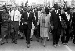 Dr. Martin Luther King Jr. and his wife, Coretta Scott King, arrive in Montgomery, Ala., on March 25, 1965, at the culmination of the Selma to Montgomery march.