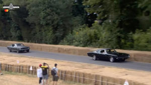 Mustang Bullitt chases Charger at Goodwood FoS
