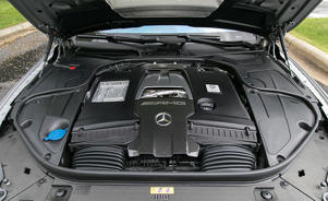 a bag of luggage sitting on top of a car: Mercedes-AMG S63 Tested: One Super Coupe