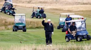 President Donald Trump walks on the course of his golf resort in Turnberry, Scotland, on July 14, 2018.