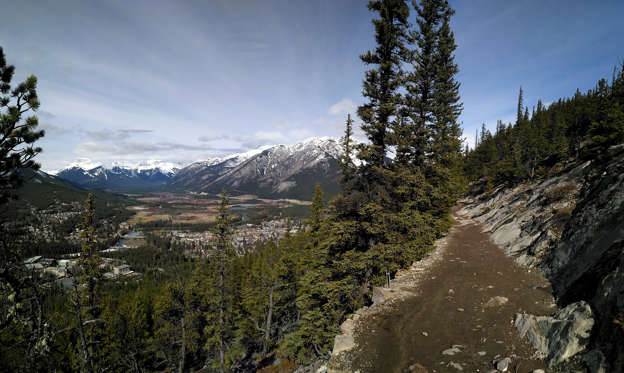 Slide 1 of 32: Hiking Trail on Sleeping Buffalo Mountain overlooking the town of Banff in Alberta, Canada