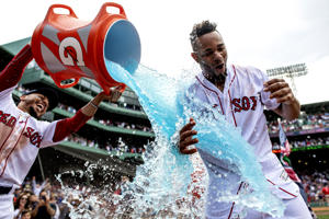 BOSTON, MA - JULY 14: Xander Bogaerts #2 of the Boston Red Sox reacts as he is doused with Gatorade by Mookie Betts #50 after hitting a walk-off grand slam home run during the tenth inning of a game against the Toronto Blue Jays on July 14, 2018 at Fenway Park in Boston, Massachusetts. (Photo by Billie Weiss/Boston Red Sox/Getty Images)