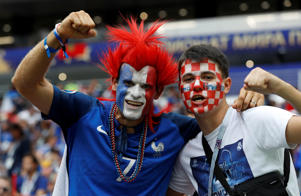 Soccer Football - World Cup - Final - France v Croatia - Luzhniki Stadium, Moscow, Russia - July 15, 2018  France fan and a Croatia fan pose for a photo inside the stadium before the match  REUTERS/Darren Staples