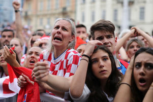Soccer Football - World Cup - Final - France v Croatia - Zagreb, Croatia - July 15, 2018 - Croatia's fans watch the broadcast of the match at the city's main square. REUTERS/Antonio Bronic