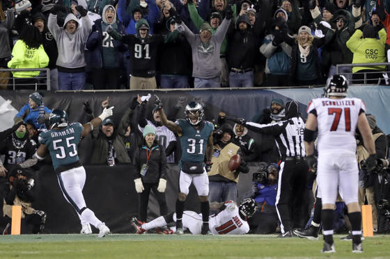 Slide 1 of 33: Philadelphia Eagles' Jalen Mills (31) and Brandon Graham (55) celebrate after Atlanta Falcons' Julio Jones cannot catch a touchdown pass during the second half of an NFL divisional playoff football game, Saturday, Jan. 13, 2018, in Philadelphia. Philadelphia won 15-10. (AP Photo/Michael Perez)