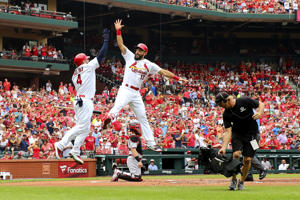 ST. LOUIS, MO - JULY 15:  Matt Carpenter #13 of the St. Louis Cardinals celebrates after hitting a home run against the Cincinnati Reds in the first inning at Busch Stadium on July 15, 2018 in St. Louis, Missouri.  (Photo by Dilip Vishwanat/Getty Images)