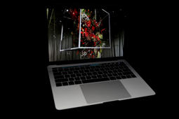 The new Apple MacBook Pro laptop computer is seen during a product launch event on October 27, 2016 in Cupertino, California. Apple Inc. unveiled the latest iterations of its MacBook Pro line of laptops and TV app.