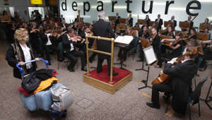 The Royal Scottish National Orchestra plays in the main check-in hall at Glasgow Airport.   (Photo by Danny Lawson/PA Images via Getty Images)