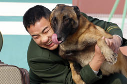JIANGSU, CHINA - NOVEMBER 28: (CHINA MAINLAND OUT)Retired army soldier Wang Xule says goodbye to his patrol dog Duoduo on 28th November 2017 in Suqian, Jiangsu, China.(Photo by TPG/Getty Images)