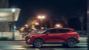 a red car parked on the side of a road: 2019 Chevrolet Blazer