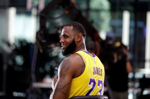 Los Angeles Lakers' LeBron James smiles as he answers questions during media day at the NBA basketball team's practice facility Monday, Sept. 24, 2018, in El Segundo, Calif. (AP Photo/Marcio Jose Sanchez)