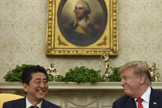 Slide 1 of 39: President Donald Trump, right, and Japanese Prime Minister Shinzo Abe, left, share a laugh during their meeting in the Oval Office of the White House in Washington, Friday, April 26, 2019. The meeting comes on the heels of the recent nuclear talks between North Korean leader Kim Jong Un and President Vladimir Putin of Russia. (AP Photo/Susan Walsh)