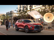a car parked on the side of a building: No description necessary—its design speaks for itself. See the 2019 Chevy Blazer for yourself at your local Chevy dealer today.  Learn more about Blazer here:  https://www.chevrolet.com/suvs/blazer-sporty-suv Find more Blazer videos here:  https://www.youtube.com/playlist?list=PL7ufN7Cep1mHcgv5TA2pvnNm0KfSBAq_l To find your local dealer:  http://www.chevrolet.com/dealer-locator  See current offers:  http://www.chevrolet.com/current-deals   About the Chevy Blazer: The latest member of the Chevrolet crossover family will arrive with bold, sophisticated styling inside and out. RS and Premier features a standard 3.6L V6 engine, making Blazer the perfect two-row midsize SUV to fuel all of your journeys, from daily commute to night on the town.   Connect with Chevy:  https://www.chevrolet.com  Facebook:  https://www.facebook.com/chevrolet  Twitter:  https://twitter.com/chevrolet  Instagram:  https://www.instagram.com/chevrolet/