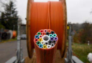 A cable drum with tubes for broadband cables.(Photo by Carsten Rehder/picture alliance via Getty Images)