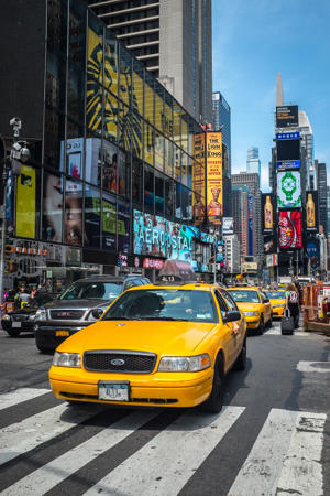 Taxis on Times Square, New York, USA. (Photo by Alexis Toureau/Gamma-Rapho via Getty Images)