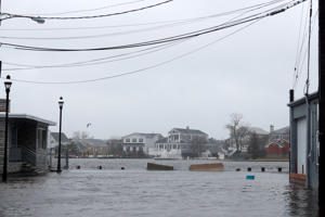 Rising tidal water from the Shrewsbury River is seen flowing along River Street on March 14, 2017 in Sea Bright, New Jersey.  Due to high winds, tidal waters from the Shrewsbury River are expected to remain several feet above regular high tide levels throughout the day. (Photo by Tom Brenner/Getty Images)