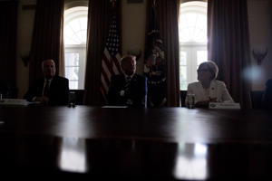 The lights go out as President Donald Trump, center, accompanied by House Ways and Means Committee chairman Rep. Kevin Brady, R-Texas, left, and Rep. Diane Black, R-Tn., right, speaks in the Cabinet room of the White House, Tuesday, July 17, 2018, in Washington. Trump says he meant the opposite when he said in Helsinki that he doesn't see why Russia would have interfered in the 2016 U.S. elections. (AP Photo/Andrew Harnik)