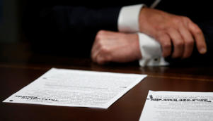 "U.S. President Donald Trump's prepared remarks show his own handwritten note ""There was no collusion"" at the top as he speaks about his summit meeting with Russian President Vladimir Putin at the start of a meeting with members of the U.S. Congress at the White House in Washington, July 17, 2018.   REUTERS/Leah Millis"
