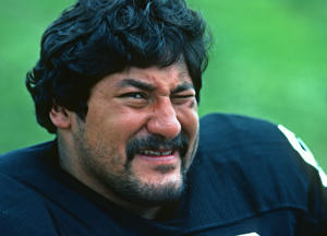 LATROBE, PA - JULY 1983:  Defensive lineman Gabe Rivera of the Pittsburgh Steelers looks on from the field during summer training camp at St. Vincent College in July 1983 in Latrobe, Pennsylvania. (Photo by George Gojkovich/Getty Images)