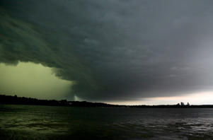 MINNEAPOLIS, MN - JUNE 11:  A severe thunderstorm rolls east towards downtown Minneapolis, lower right, seen from the south side of Lake Harriet on Sunday, June 11, 2017 in Minneapolis, Minnesota. (Photo by David Joles/Minneapolis Star Tribune/TNS via Getty Images)