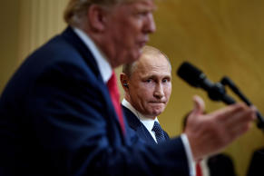 Russia's President Vladimir Putin listens while US President Donald Trump speaks during a press conference at Finland's Presidential Palace July 16, 2018 in Helsinki, Finland.