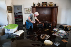 LONGS, SC - SEPTEMBER 20: Billy Hardee removes valuables from his home as floodwater caused by Hurricane Florence rises at Aberdeen Country Club on September 20, 2018 in Longs, South Carolina. Floodwaters are expected to rise through the weekend in the area. (Photo by Sean Rayford/Getty Images)
