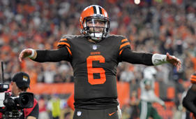 Cleveland Browns quarterback Baker Mayfield celebrates a 1-yard touchdown by running back Carlos Hyde during the second half of an NFL football game against the New York Jets, Thursday, Sept. 20, 2018, in Cleveland. The Browns won 21-17. (AP Photo/David Richard)