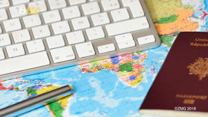 a laptop computer sitting on top of a keyboard: Pick These Places For Group Travel, And You'll Still Be Friends When The Vacation Is Over