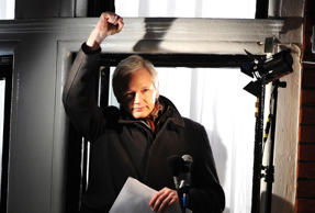 Julian Assange speaks on the balcony of the Ecuadorian Embassy in London.