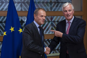 European Council President Donald Tusk, left, greets EU chief Brexit negotiator Michel Barnier before their meeting at the EU Council building in Brussels, Thursday, Sept. 13, 2018. (AP Photo/Francisco Seco, Pool)