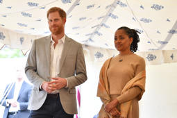 Britain's Prince Harry (L), Duke of Sussex and Doria Ragland listen to Meghan, Duchess of Sussex speaking at an event to mark the launch of a cookbook with recipes from a group of women affected by the Grenfell Tower fire at Kensington Palace in London on September 20, 2018. (Photo by Ben STANSALL / POOL / AFP)        (Photo credit should read BEN STANSALL/AFP/Getty Images)