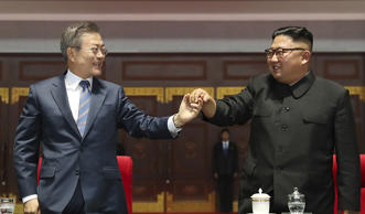 "South Korean President Moon Jae-in and North Korean leader Kim Jong Un hold their hands together after watching the mass games performance of ""The Glorious Country"" at May Day Stadium in Pyongyang, North Korea."
