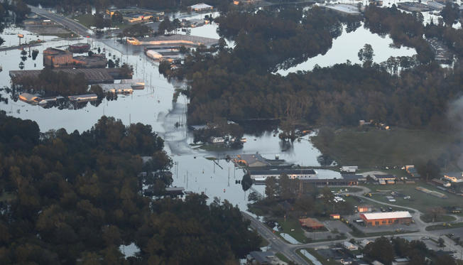 Slide 1 of 106: Areas of Kinston, N.C., are still under water late Friday, Sept. 21, 2018, as a result of Hurricane Florence. (Scott Sharpe/Raleigh News & Observer/TNS via Getty Images)