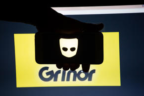 The logo of the dating app Grindr is seen on a mobile screen and a laptop screen. Several millions use the gay dating app daily.