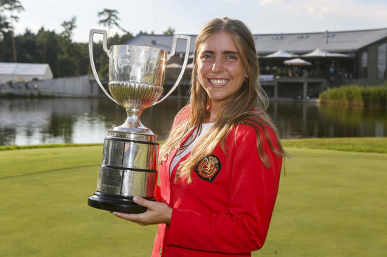 Slide 3 of 87: A handout photo made available by the European Golf Association 18 September 2018 of Spanish golfer Celia Barquin Arozamena with the winner's trophy at the . European Ladies' Amateur Championship at Penati Golf Resort, Slovakia, 28 July 2018. Arozamena's body was found on the Coldwater Links Golf Course in Ames, Iowa 17 September 2018 after golfers found her abandoned golf bag in the middle of a fairway.