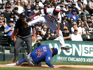 CHICAGO, IL - SEPTEMBER 23: Anthony Rizzo #44 of the Chicago Cubs is safe at third base as Tim Anderson #7 of the Chicago White Sox takes a late throw during the first inning on September 23, 2018 at Guaranteed Rate Field  in Chicago, Illinois. (Photo by David Banks/Getty Images)