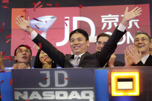 "FILE - In this file photo taken Thursday, May 22, 2014, Liu Qiangdong, also known as Richard Liu, CEO of JD.com, raises his arms to celebrate the IPO for his company at the Nasdaq MarketSite, in New York. An attorney for Liu welcomes a decision by Minnesota prosecutors not to charge Liu after a Chinese college student accused him of sexual assault. The attorney says Liu was arrested ""based on a false claim,"" and the decision not to file charges ""vindicates him."" Prosecutors said Friday, Dec. 21, 2018, that ""profound evidentiary problems"" would have made it ""highly unlikely"" to prove any charges beyond a reasonable doubt. (AP Photo/Mark Lennihan, File)"