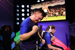 MAIDSTONE, ENGLAND - APRIL 14: Corentin 'MAESTRO' Thullier of France celebrates as his teammate Lucas 'DaXe' Cuillerier of France scored in the X-box leg of the Final between Argentina and France during Day 2 of FIFA eNations Cup 2019 on April 14, 2019 in Maidstone, England. (Photo by Dan Mullan - FIFA/FIFA via Getty Images)