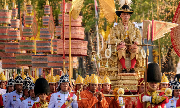 Slide 2 of 32: BANGKOK, THAILAND - MAY 05: Thailand's newly crowned King Maha Vajiralongkorn is carried in a golden palanquin during the coronation procession on May 5, 2019 in Bangkok, Thailand. Thailand held its first coronation for the first time in nearly seven decades as King Maha Vajiralongkorn, also known as Rama X, was crowned on Saturday following an extended mourning period for King Bhumibol Adulyadej, who died in October 2016 at the age of 88. The elaborate three-day ceremony reportedly cost around $31 million as King Vajiralongkorn circled around parts of Bangkok on a royal palanquin after being presented with a gold 7.3-kilogram crown and a sacred nine-tiered umbrella. (Photo by Linh Pham/Getty Images)