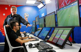FIFA VAR Refereeing Project Leader Roberto Rosetti (top) demonstrates a video operation room (VOR), a facility of the Video Assistant Referee (VAR) system which will be rolled out for the first time at a World Cup, in Moscow, Russia June 9, 2018. REUTERS/Sergei Karpukhin