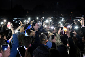 "HIGHLANDS RANCH, CO - MAY 8:  Students protesting the media and politicians brought their vigil outside of Highlands Ranch High to honor their fallen friend Kendrick Castillo by lighting up their phones in the rain on May 8, 2019 in Highlands Ranch, Colorado.  STEM students at the vigil burst into a spontaneous demonstration after they were asked to speak at the organized event. The students left the gym and started chanting ""mental health"" and ""F--k the media"" as the gathering derailed into a protest against politics and the media. The students eventually returned to the gym and spoke about Castillo in an open microphone forum at the podium in the middle of the gym.  (Photo by Helen H. Richardson/MediaNews Group/The Denver Post via Getty Images)"