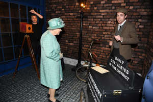 Britain's Queen Elizabeth tours inside a replica of one of the original Sainsbury's stores in Covent Garden.