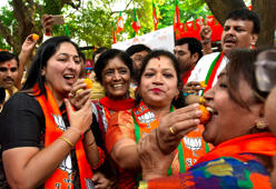 BJP workers celebrate as NDA heads for landslide win
