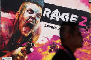 LOS ANGELES, CA - JUNE 12:  A man walks past a poster for 'Rage 2' during the Electronic Entertainment Expo E3 at the Los Angeles Convention Center on June 12, 2018 in Los Angeles, California.  (Photo by Christian Petersen/Getty Images)