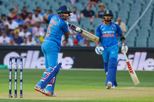 Indian batsman Ambati Rayudu (L) plays a shot while watched by Indian captain Virat Kohli (R) during the second one-day international cricket match between Australia and India at the Adelaide Oval on January 15, 2019. (Photo by Brenton EDWARDS / AFP) / -- IMAGE RESTRICTED TO EDITORIAL USE - STRICTLY NO COMMERCIAL USE --        (Photo credit should read BRENTON EDWARDS/AFP/Getty Images)