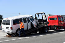 SEAL BEACH, CA - MARCH 13: A tow truck driver loads up a van following a traffic collision on the 405 North freeway at the 605 North interchange in Seal Beach on Wednesday, March 13, 2019. The collision resulted in 18 people injured and 2 trauma patients transported to a local hospital.  (Photo by Brittany Murray/MediaNews Group/Long Beach Press-Telegram via Getty Images)