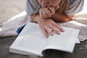 Young Girl reading book.