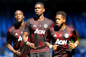 Manchester United's Paul Pogba (centre) warms up ahead of the Premier League match at Goodison Park, Liverpool. (Photo by Martin Rickett/PA Images via Getty Images)